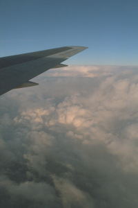 Some clouds with a wing